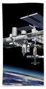Space Station In Orbit Around Earth Beach Towel by Leonello Calvetti