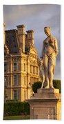 Statue Below Musee Du Louvre Beach Towel