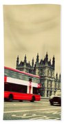 London Uk Red Bus In Motion And Big Ben Beach Towel