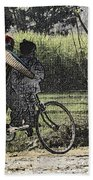 3 Young Children On A Cycle At The Side Of The Road Beach Towel
