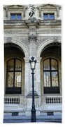 Ornate Architectural Artwork On The Buildings Of The Musee Du Louvre In Paris France Beach Towel