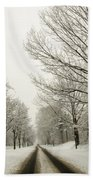 Snow Covered Road And Trees After Winter Storm Beach Towel