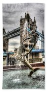 Tower Bridge And The Girl And Dolphin Statue Beach Towel