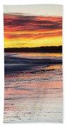 Bamburgh Castle At Sunrise Beach Towel