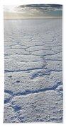 sunrise at Salar de Uyuni worlds largest salt lake Bolivia Beach Towel