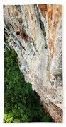 A Athletic Man Rock Climbing High Beach Towel