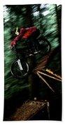 A Biker Rides His Mountain Bike Beach Towel
