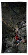 A Climber On A Rock Face Beach Towel