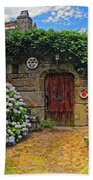 A Courtyard In Brittany France Beach Towel
