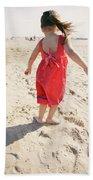 A Cute Little Hispanic Girl Wearing Beach Towel