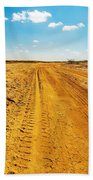 A Dirt Road In The Desert Beach Towel