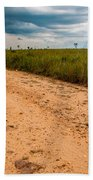 A Dirt Road In The Plains Beach Towel