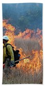 A Firefighter Ignites The Norbeck Prescribed Fire. Beach Towel