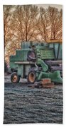 A Frosty John Deere Turbo 7700 Combine Beach Towel