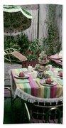 A Garden Set Up For Lunch Beach Sheet