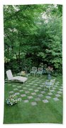 A Garden With Checkered Pavement Beach Sheet