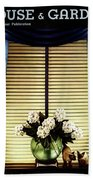 A House And Garden Cover Of Flowers By A Window Beach Towel