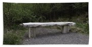 A Long Stone Section Over Wooden Stumps Forming A Rough Sitting Area Beach Towel
