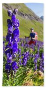 A Male Hiker In Sunny Flower Field Beach Towel