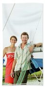 A Man And A Woman Embrace In Sailboat Beach Towel