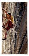 A Man Climbing A Big Wall In El Potrero Beach Towel