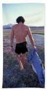 A Man Takes Off His Clothes And Walks Beach Towel