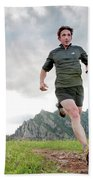 A Man Trail Runs Along The Spring Brook Beach Towel