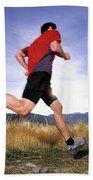 A Man Trail Runs In Salt Lake City Beach Towel