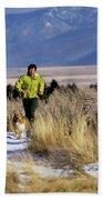A Man Trail Runs On A Winter Day Beach Sheet