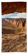 A Mountain Biker Rides By On Slickrock Beach Towel