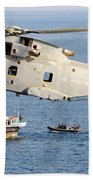 A Royal Navy Merlin Helicopter  Beach Towel