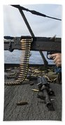 A Sailor Fires An M-240b Machine Gun Beach Towel by Stocktrek Images
