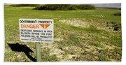 A Sign Warns Of Dangerous Unexploded Beach Sheet