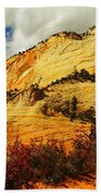 A Tree And Orange Hill Beach Towel