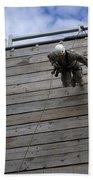 A U.s. Soldier Runs Down A 40-foot Beach Sheet