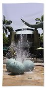 A Water Fountain With Dinosaur Eggs And Dinsosaurs In Universal Studios Beach Towel