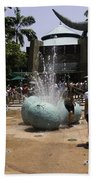 A Water Fountain With Dinosaur Eggs In Universal Studios Singapore Beach Towel
