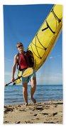 A Woman Carrying Her Sea Kayak Beach Towel