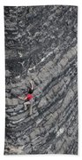 A Woman Climbs Above Her Protection Beach Towel