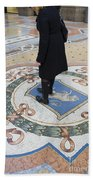 A Woman Rubs Her Heel For Good Luck On The Crest Of The Bull In Galleria Vittorio Emanuele II  Beach Towel