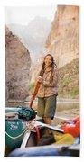 A Woman Unloads Gear From Her Canoe Beach Towel
