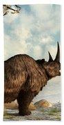 A Woolly Rhinoceros Trudges Beach Towel by Daniel Eskridge