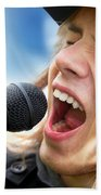 A Young Man Sings To A Microphone Beach Towel