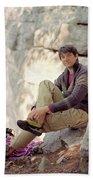 A Young Rock Climber Puts On A Climbing Beach Towel