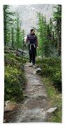 A Young Woman Walks Along An Sub-alpine Beach Towel