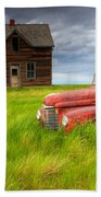 Abandoned Homestead House And Red Beach Towel