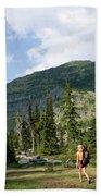 Adult Woman Hiking Through An Alpine Beach Towel