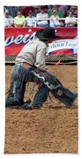 American Cowboy Thrown From A  Bucking Rodeo Bronc Beach Towel