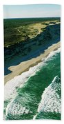 An Aerial View Of Waves Hitting Beach Towel