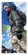 An Extreme Snowboarder Stands Beach Towel